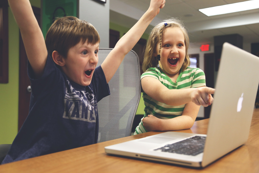 kids celebrate computer coding in library