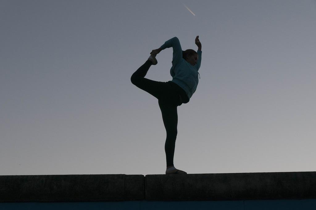 woman stretching dusk sunrise yoga silhouette-607905_1920
